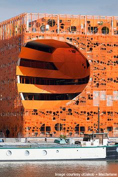 The Orange Cube, Lyons, France; cultural and office building; Jakob + Macfarlane Architects; 2011. The circular patterns on the perforated aluminium façade allow natural light, air and views.