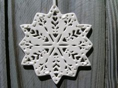 Reindeer Snowflake by canterburypottery on Etsy, $32.00  I love this Etsy shop and I display my snowflake all year because it's so pretty!