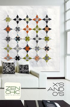 Tradition meets modern: A well-known paper pieced block combined with modern and fresh graphic prints in a black and white palette with a splash of color. Enhanced by a spectacular quilting. Using REEL TIME by ZEN CHIC