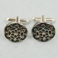 Upcycled Cufflinks by knowntoman, a Brighton Etsy seller. If you buy this pair part of the profits are donated to Shelter.