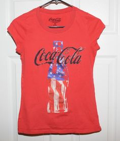 Vintage Coca-Cola Graphic Tee Shirt in Girl's Size Junior Medium with Old Glory inside the Coke bottle design. Coca Cola, Womens Vintage Tees, Graphic Tee Shirts, Bottle Design, Coco, Red, Mens Tops, Medium, Fashion