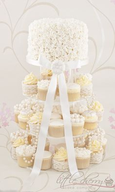Ivory Ruffle Cupcake Tower - Vintage style Ivory Ruffle cake with matching cupcakes, edible brooches, pearls...pretty