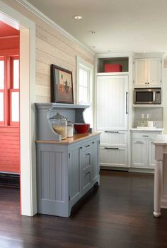 Detailed and painted to look like vintage furniture, the hutch has a cypress countertop. Tongue-and-groove boards laid horizontally evoke an old convention, adding warmth and texture to a contemporary space. l Early Homes Magazine