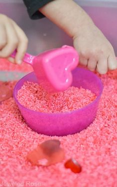 Rose Rice Recipe - Little Bins For Little Hands - Rose Rice Recipe Valentines play rice recipe and sensory bin- this scented rice smells glorious, has therapeutic attributes, and there are lots of fun ways for kids to play and explore. Valentine Sensory, Valentine Theme, Valentines Day Activities, Valentines Day Party, Valentines For Kids, Valentine Day Crafts, Activities For Kids, Valentine Ideas, Valentines Ideas For Preschoolers