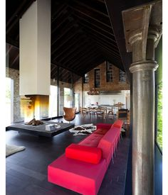 Fireplace with red sofa and leather Egg chair (design Arne Jacobsen) - photo Tim Van De Velde
