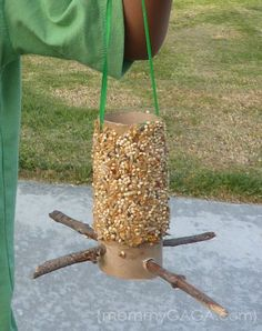 How To Make A Bird Feeder {Fun Summer Crafts for Kids} - using toilet paper roll, sticks, bird seed, peanut butter (could use soy butter if peanut allergy), & ribbon.  Easy & fun.  Made these with K-3rd graders and a four year old.  Super fun!  We used soy butter.
