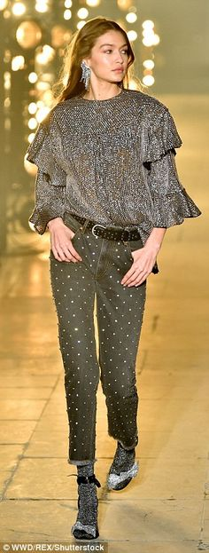 Catwalk queen: She's put on a fashion masterclass so far during Paris Fashion Week. And Gigi Hadid, 21, was at it again on Thursday as she wowed on the runway at the Isabel Marant Autumn/Winter 2017 PFW show