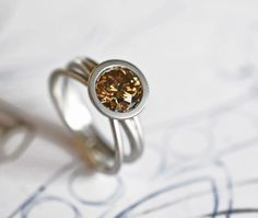 Nest ring with 1 carat honey diamond