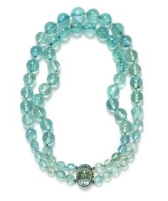 A Silver, Aquamarine and Green Beryl Double Strand Necklace, Suzanne Belperron. Estimate $7,000-9,000