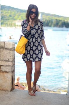 I love the pop of the yellow bag with the blue of the dress.   It's hard to find lovely cover ups like is that actually do cover up! Sometimes enough sun is enough sun....