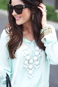 Mint chiffon blouse, J Crew white bubble statement necklace, and exaggerated cat eye sunglasses