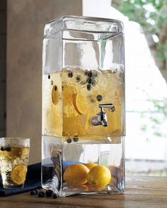 For a Summer Party: A 3-Tier Stacked Glass Drink Dispenser | Ideal for our family needs....Sweet and Unsweetened Tea, and Lemonade.  Great idea!