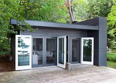 Modern Cabin on Lake Michigan - A minimalist take on the traditional summer cottage, this petite home sits on a private stretch of lakefront in a leafy gated community. Casas Containers, Cabins In The Woods, Lake Michigan, Little Houses, Tiny Houses, Exterior Design, Black Exterior, Modern Exterior, Exterior Doors