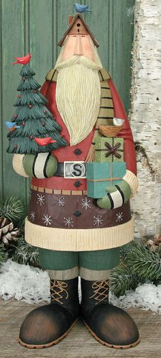 Santa Holding a Tree and Presents Figurine