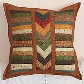 Patchwork cushion in browns and greens. Throw pillow, kissen