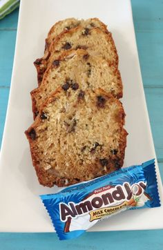 Almond Joy Bread - A light, fluffy, healthy quick bread chock full of coconut, chocolate and almonds. Tastes identical to an Almond Joy Candy Bar! Just Desserts, Delicious Desserts, Dessert Recipes, Yummy Food, Cooking Bread, Fruit Bread, Almond Joy, Sweet Bread, Coffee Cake