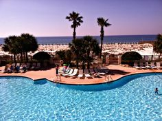 Beach Club, on the Fort Morgan Peninsula outside Gulf Shores, is a gated resort with multiple swimming pools, a spa and fitness center, a concert pavilion, and a seasonal tiki bar.