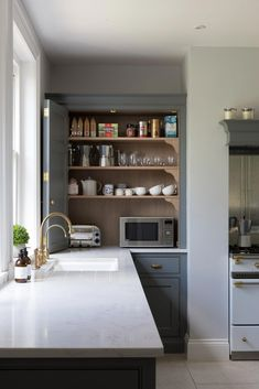 Microwave inside the cabinet + toaster in the cabinet + bifold cabinet door in the kitchen + dark gray cabinets   Humphrey Munson #Kitchenideas