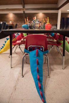 No doubt these Dinosaur tails decorating the chairs at this party must have been a massive hit! See more party ideas at CatchMyParty.com