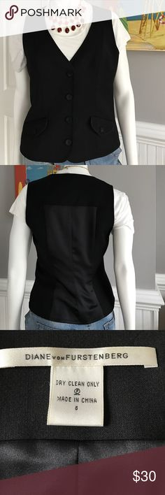 Classic  DVF Tuxedo Vest Fashion might change but style remains! Dress this classy tuxedo vest up or down! Great with a white dress shirt ,simple tee, an all black ensemble or on bare skin... possibilities  are endless with this classic beauty! Size 8 , deep black with front pockets and a silky tux paneled back! Diane von Fürstenberg. Timeless and classy. Diane von Furstenberg Jackets & Coats Vests