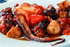 Octopus dishes are popular in Spanish, Italy and Greece. The main secret of cooking perfect seafood with vegetables is to choose a good . Food, in this Greek Octopus Recipe, Octopus Recipes, Seafood Recipes, Mexican Food Recipes, Ethnic Recipes, Carrot Greens, Good Food, Yummy Food, Create A Recipe