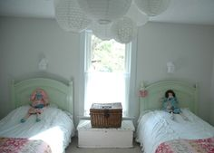 Love the group of hanging lamps and the lamps above the beds, cheap exterior lights with ruffly fabric added