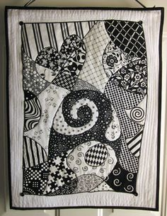 Do you love to zentangle? Do you love to quilt? Combine them both and you get a unique and fun concept in quilting. Although the official zentangle is made