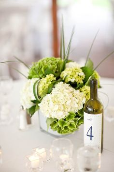 Love the flowers and the wine bottle table number!