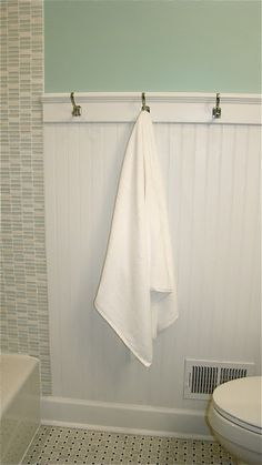 Beadboard and hooks instead of a towel bar. I like the tile, too. The Vintage Glitter House: Girl's Bathroom Remodel on a Budget