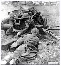 German soldiers at Stalingrad fire a 5 mm Pak 38 anti-tank gun