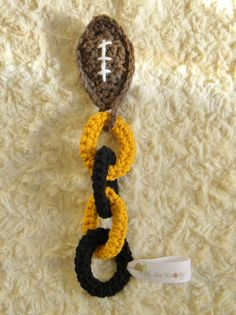 Baby teething ring chain. 100% Cotton Football Team-Inspired Steelers, Saints... #OhSewKnotty