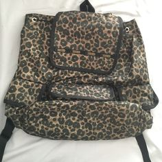 NWOT Cheetah backpack The backpack is greener than it is coming out in the photo. NWOT. Please submit an offer if interested.   *ship same/ next day *pet/smoke free home *no holds/trades Le Sports SAC Other