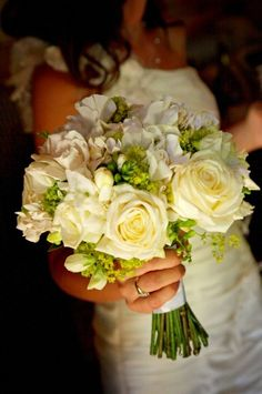 Love the white with a touch of green as possible bridemaid's bouquets!