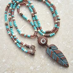 Feather totem necklace ceramic feather pendant by THEAjewellery