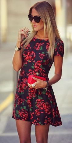 I love this black dress with the red roses and a red clutch to match. Day time!