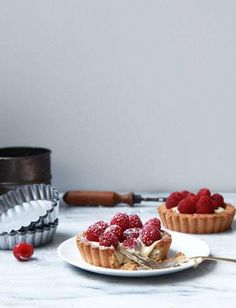Raspberry tarts with crust and creme patissiere