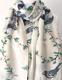 A large cream scarf with a bird print The scarf is long wide and very soft with…