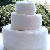 How to make a Towel Cake.  She even has a video explaining it.