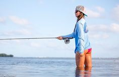 Nice picture of a pretty girl fly fishing
