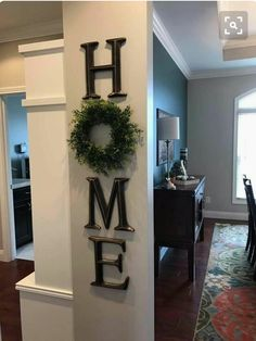 HOME... Using a boxwood wreath for the 'O'. Love this.