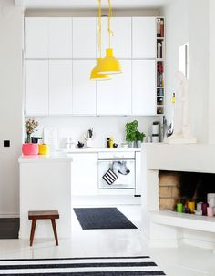 Breton stripes in kitchen with a pop of yellow looks both fun and sophisticated. For more decorating and pendant light ideas, visit http://www.redonline.co.uk