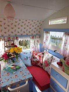 An angel in the garden: Lucy, Our Sweet Vintage Caravan