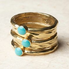 Biji: Aqua Bead Stacking Rings $40  Organic-shaped bands of 18-karat gold plate add a rich shimmer with aqua resin beads. Set of five stacking rings. All sales are final. No returns, exchanges or refunds. No warranties or guarantees.