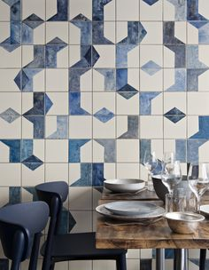 A closer look at the hand-painted, ceramic tile fresco on the ground level of Belle Maison. Bonaventure also specified ceramic dishes and tableware from Broste Copenhagen; the navy blue Nemea chairs are from Pedrali.