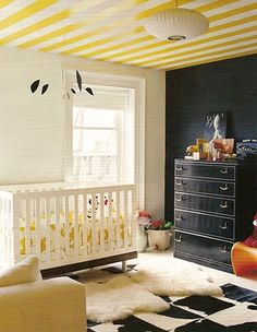 Interesting baby room idea, black wall. Love the ceiling.