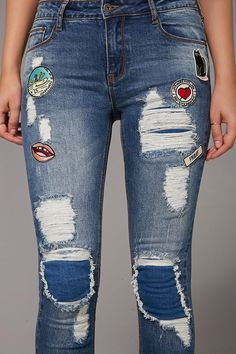 "A pair of skinny jeans featuring a ""Happiness Is In You"" alligator and various patches, a distressed design, five-pocket construction, and a zipper fly."
