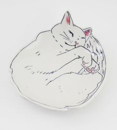 Serve up breakfast scones and slices of homemade pie on this adorable hand painted dessert plate. Each plate is formed from white porcelain clay and carved with the sleepy cat design once almost dry.