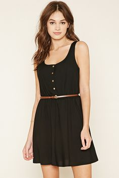 A sleeveless, woven dress featuring a skinny faux leather belt, snap buttons at the front, vertical cutouts at the back and an elasticized waist.