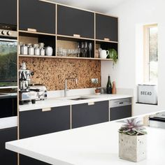 Fenix and birch kitchen with spacer panels by Plykea