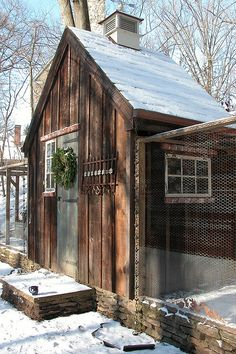 Great rock wall and chicken fencing. Wonderful vintage coop.